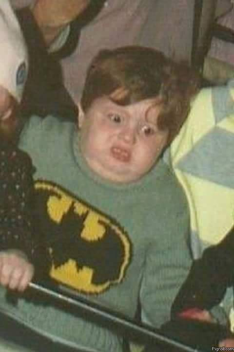 Kid in a Batman sweater