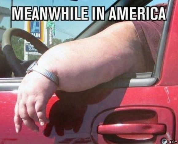 A fat arm hanging out of a car - must be America