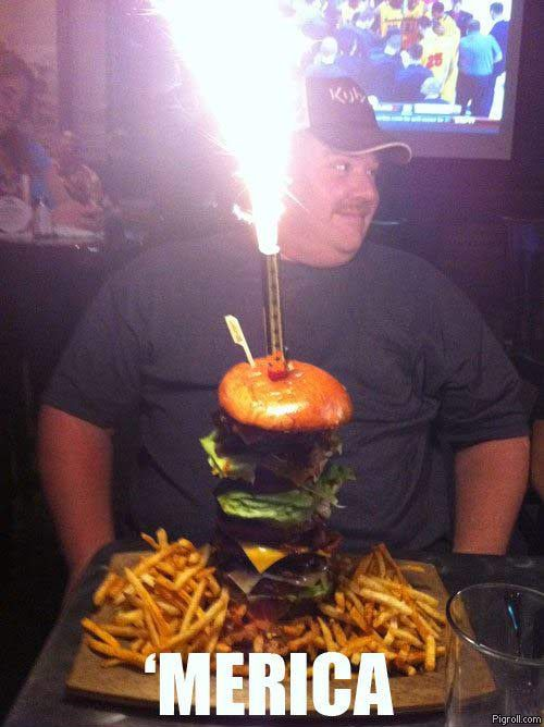 Typical fat American celebrating his birthday with a huge hamburger and fries